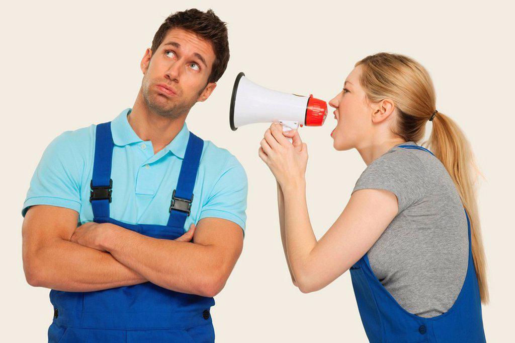 Stock Photo: 1815R-66681 Woman shouting at man through megaphone, close_up