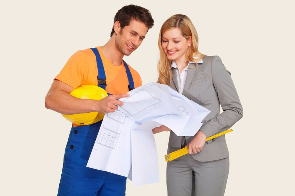 Construction worker and architect looking at blueprint : Stock Photo