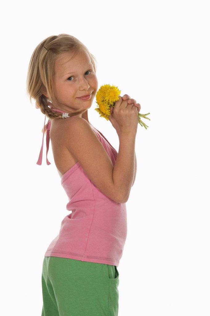 Stock Photo: 1815R-67163 Girl 10_11 holding dandelion flowers, side view, portrait