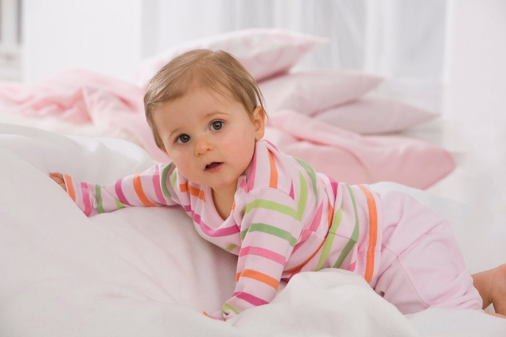 Baby girl 6_11 months crawling on blanket : Stock Photo