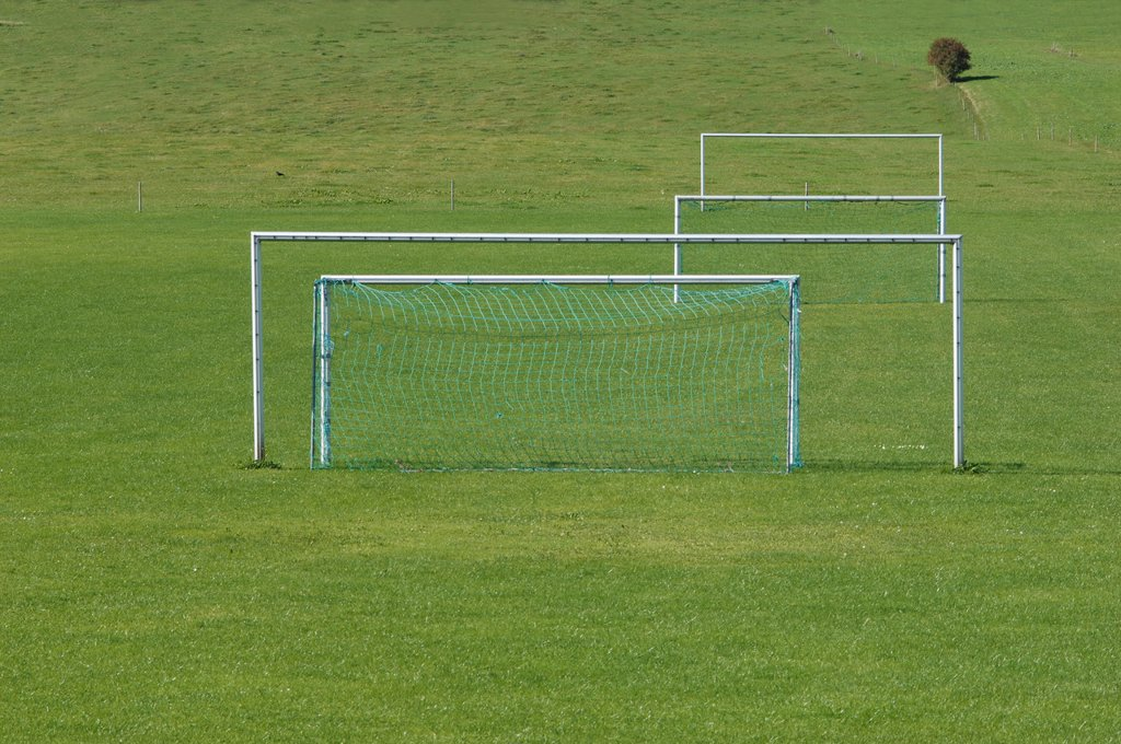 Goal posts on grass pitch. : Stock Photo