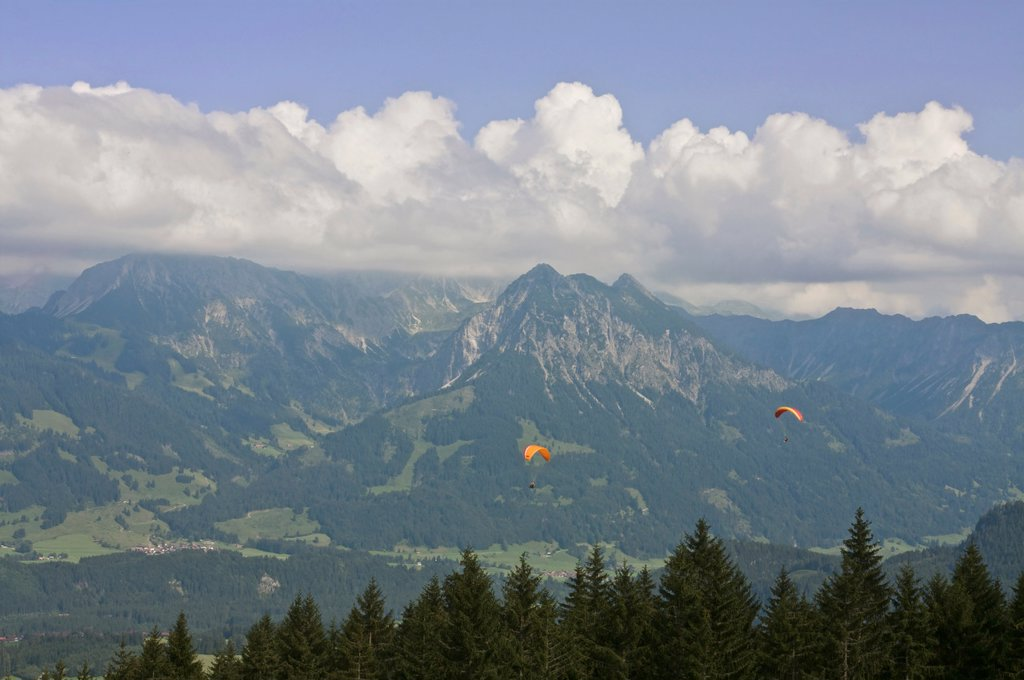 Germany, Allgaeu, Bavaria, View of hang_gliding fying over fischen area : Stock Photo