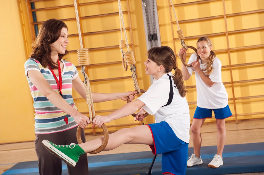 Stock Photo: 1815R-68909 Germany, Emmering, Woman training girls