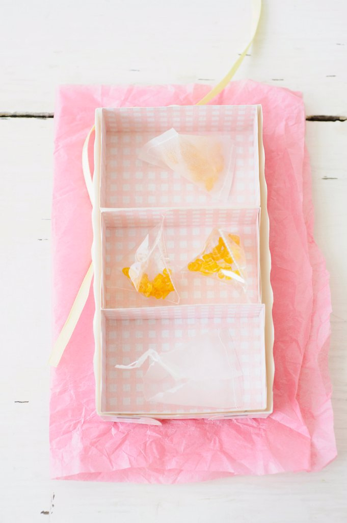 Candied lemon twist in rack on wax paper : Stock Photo