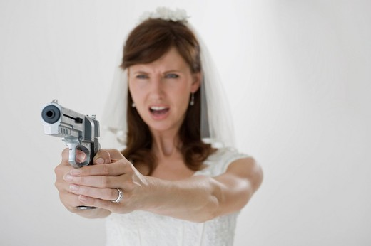 Bride holding pistol : Stock Photo