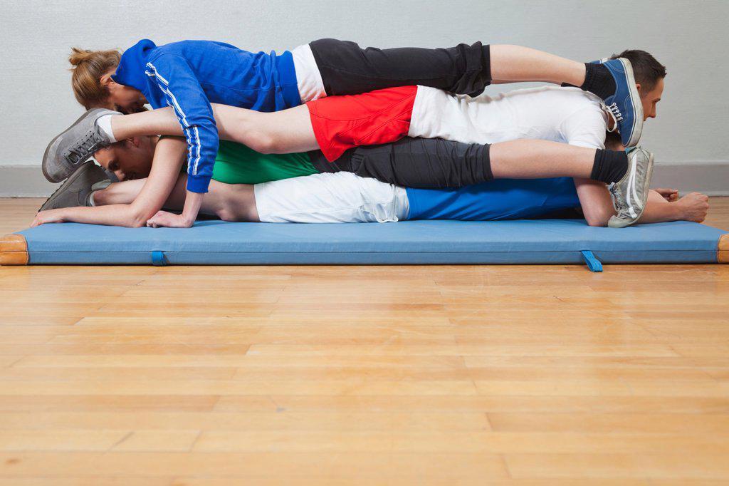 Germany, Berlin, People lying on mat : Stock Photo