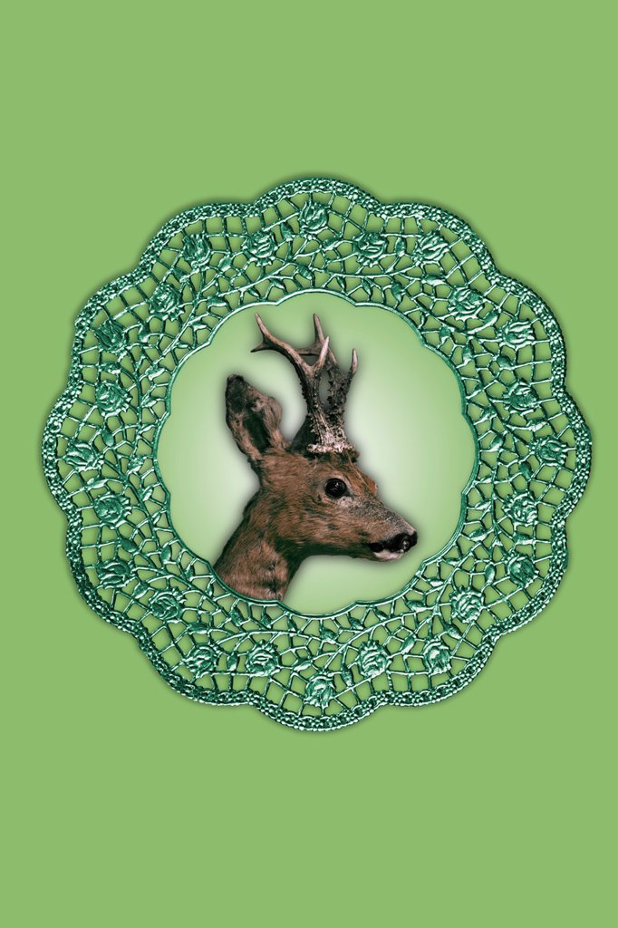 Deer collage artwork in picture frame against green background : Stock Photo