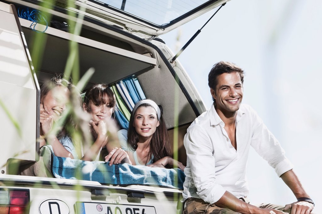 Stock Photo: 1815R-72678 Germany, Cologne, Man and women in bus, smiling