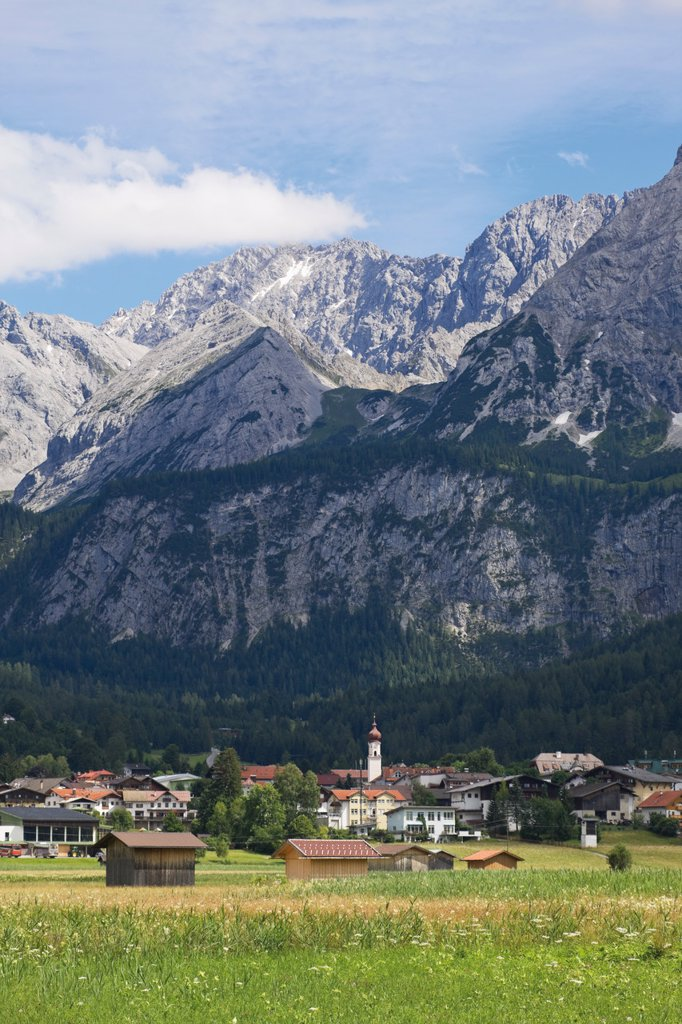 Austria, Tyrol, Mieming, Ehrwald, View of village with mountain ranges : Stock Photo