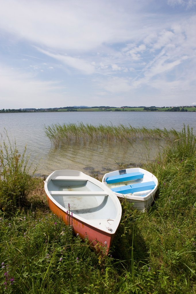 Stock Photo: 1815R-73589 Austria, Land Salzburg, View of boats in reed near wallersee lake