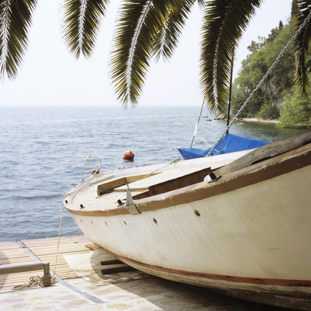 Italy, Gardasee, Boat by lake : Stock Photo