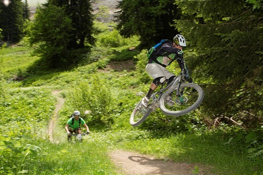 Stock Photo: 1815R-76757 France, Porte du Soleil, Savoien, Mountainbikers riding bike in funpark
