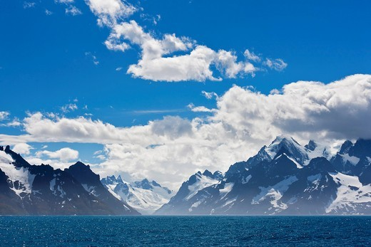 Stock Photo: 1815R-78005 South Atlantic Ocean, United Kingdom, British Overseas Territories, South Georgia, View of mountains with ocean