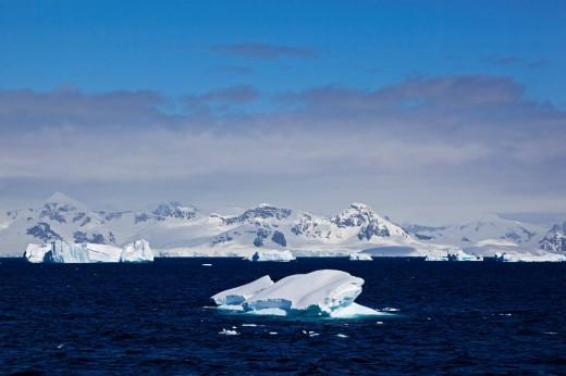 South Atlantic Ocean, Antarctica, Antarctic Peninsula, Gerlache Strait, View of iceberg with snow_covered mountain range : Stock Photo