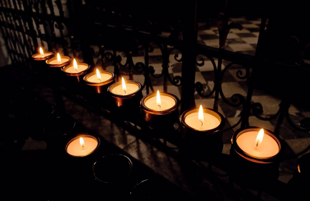 Austria, Karlskirche, Large group of candlelights burning, close-up : Stock Photo