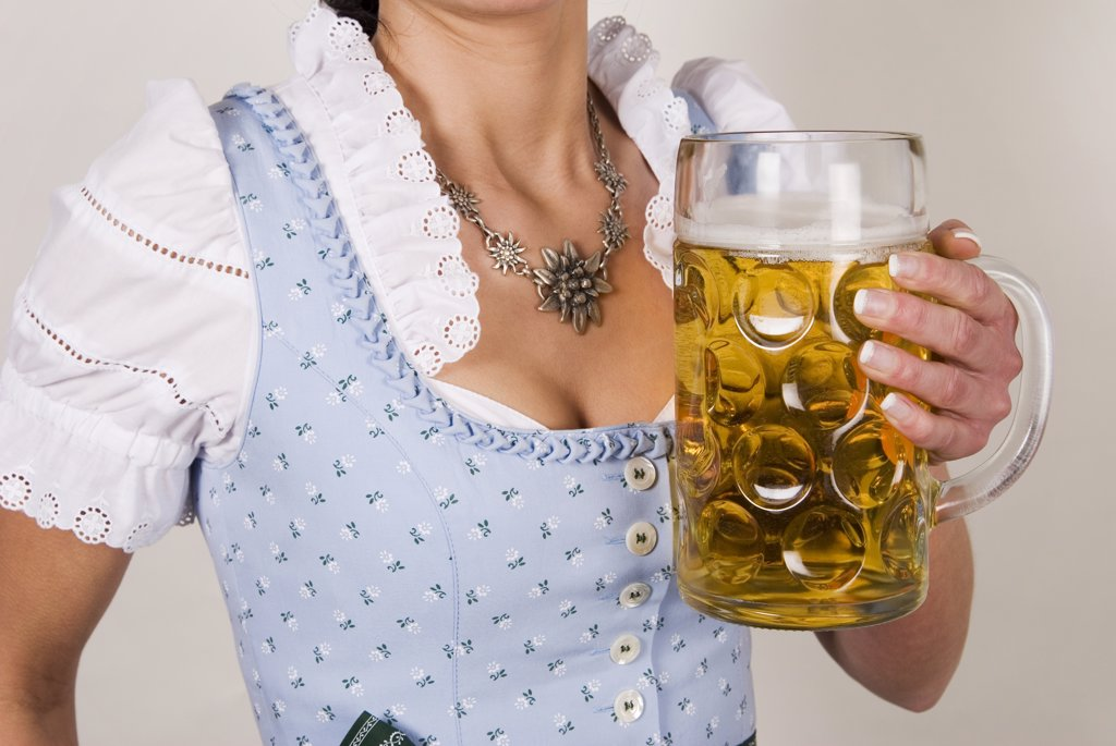 Stock Photo: 1815R-8007 Woman holding beer stein, upper section