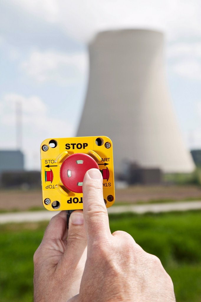 Stock Photo: 1815R-80305 Germany, Bavaria, Unterahrain, Hand of man pressing shut off button near AKW Isar
