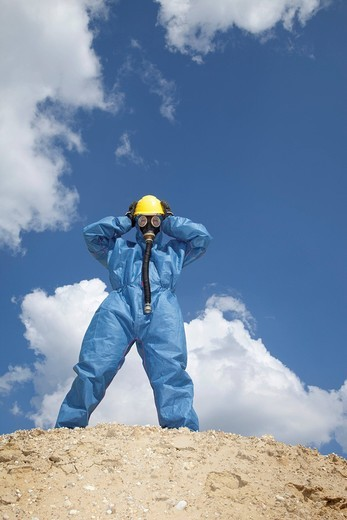 Germany, Bavaria, Man in protective workwear standing on top of sand dune : Stock Photo