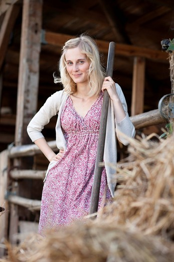 Germany, Saxony, Young woman at the farm, portrait : Stock Photo