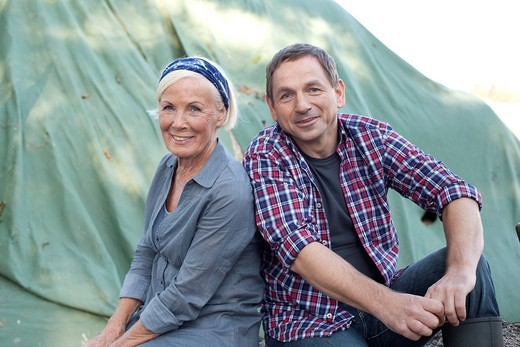 Germany, Saxony, Man and woman smiling, portrait : Stock Photo