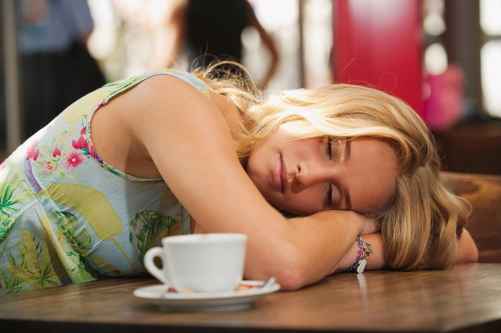 Germany, Munich, Teenage girl resting in cafe : Stock Photo