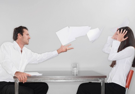 Stock Photo: 1815R-85501 Business man throwing papers with woman head in hand