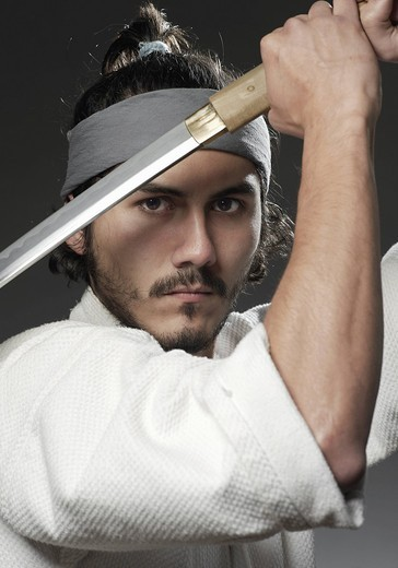 Samurai with sword, portrait : Stock Photo