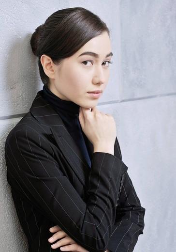 Teenage girl in dark jacket, portrait : Stock Photo