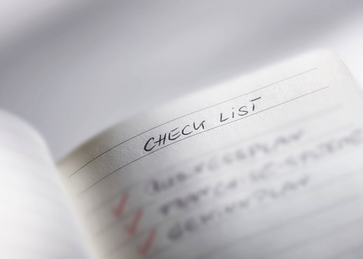 Check list in notebook, close up : Stock Photo