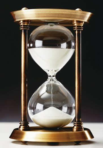 Hourglass on black background, close up : Stock Photo