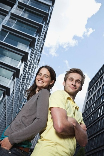 Germany, Berlin, Man and woman smiling, portrait : Stock Photo