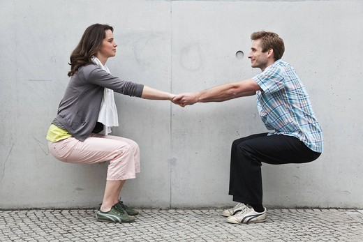 Germany, Berlin, Man and woman playing against wall : Stock Photo