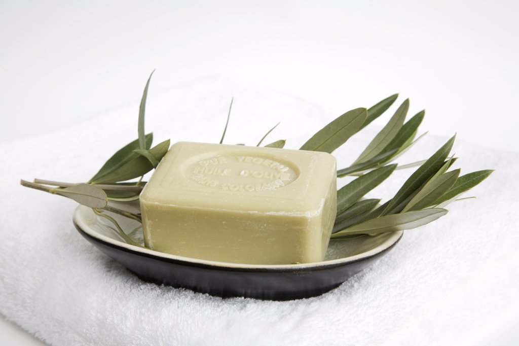 Olive soap on soap dish, close-up : Stock Photo