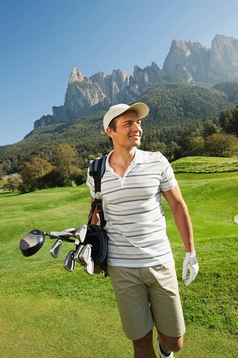 Stock Photo: 1815R-87443 Italy, Kastelruth, Mid adult man walking on golf course