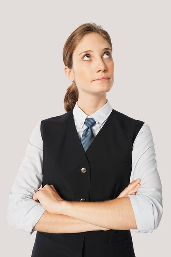 Close up of young air stewardess with arms crossed against white background : Stock Photo