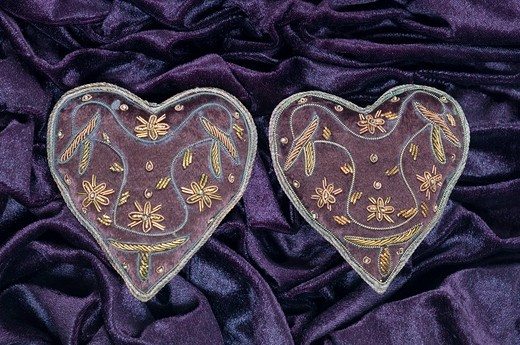 Heart shape with embroidery on velvet : Stock Photo