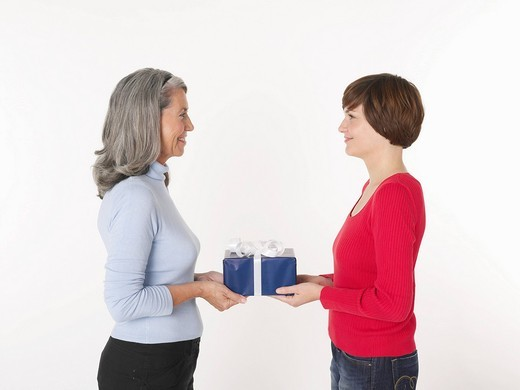 Stock Photo: 1815R-92205 Daughter giving present to her mother