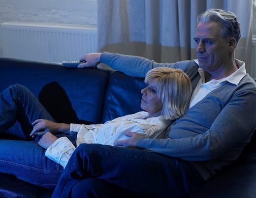 Stock Photo: 1815R-92435 Germany, Hamburg, Couple on sofa watching tv