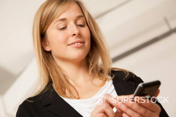 Young woman using smart phone : Stock Photo