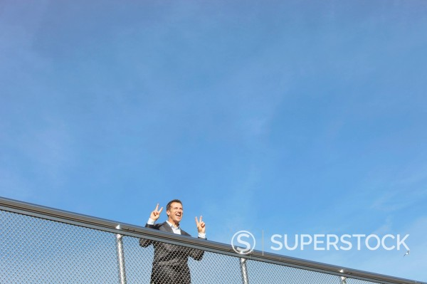 Stock Photo: 1815R-94237 Germany, Bavaria, Munich, Businessman standing near railings, smiling