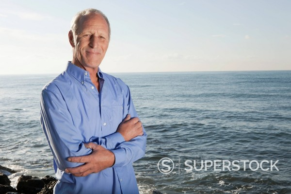 Spain, Mallorca, Senior man standing at sea shore, portrait : Stock Photo