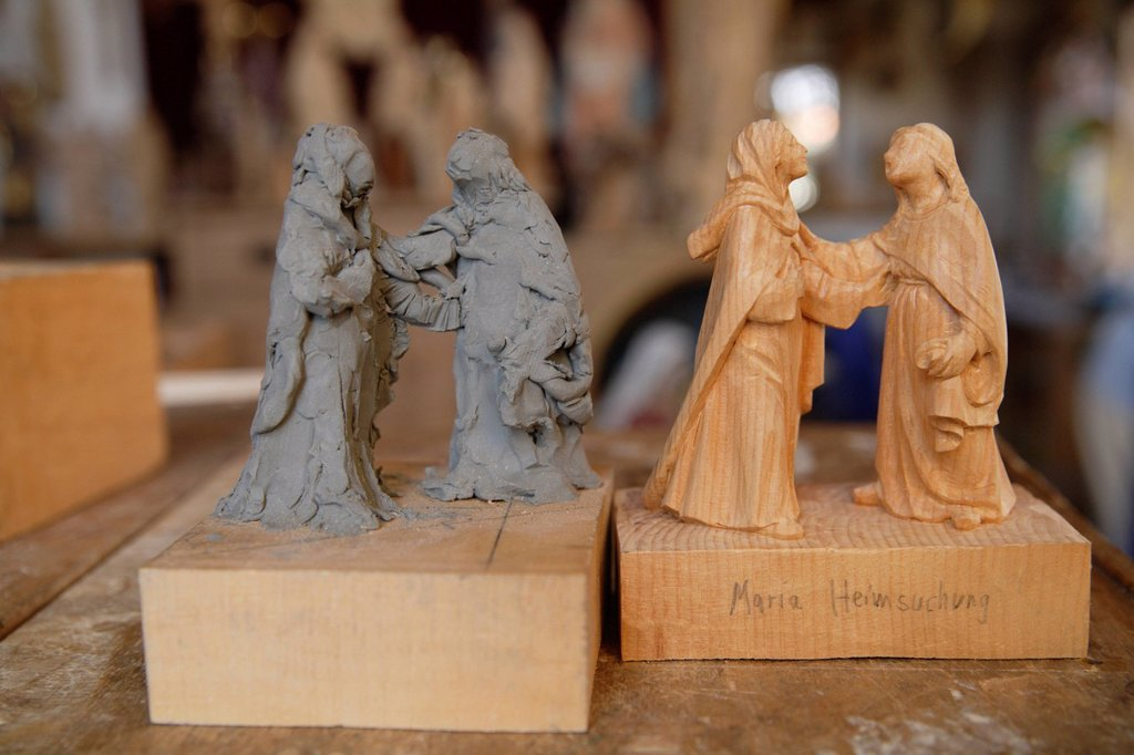 Germany, Upper Bavaria, Statues at wood carver studio, close up : Stock Photo