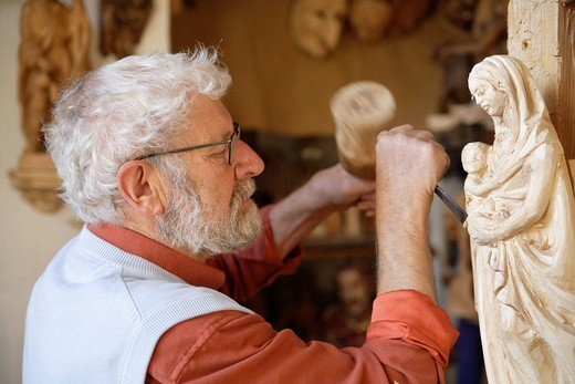 Germany, Upper Bavaria, Craftsperson carving statue : Stock Photo