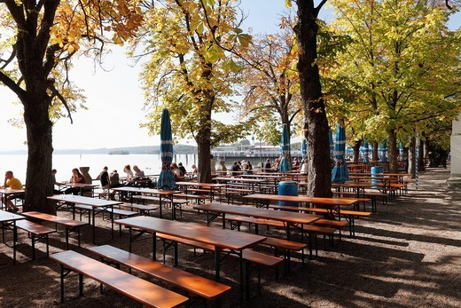 Germany, Bavaria, Upper Bavaria, Fuenfseenland, Tourist at beer garden near lake : Stock Photo