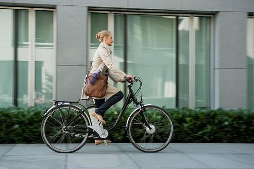 Germany, Bavaria, Teenage girl riding bicycle : Stock Photo
