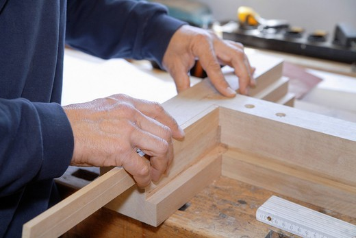 Germany, Upper Bavaria, Schaeftlarn, Carpenter fixing wood : Stock Photo