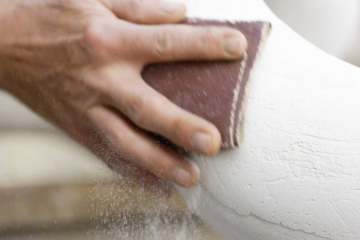 Stock Photo: 1815R-96520 Germany, Upper Bavaria, Munich, Schaeftlarn, Sculptor polishing plaster