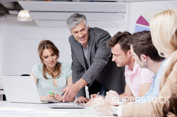 Germany, Bavaria, Munich, Men and women discussing in office : Stock Photo