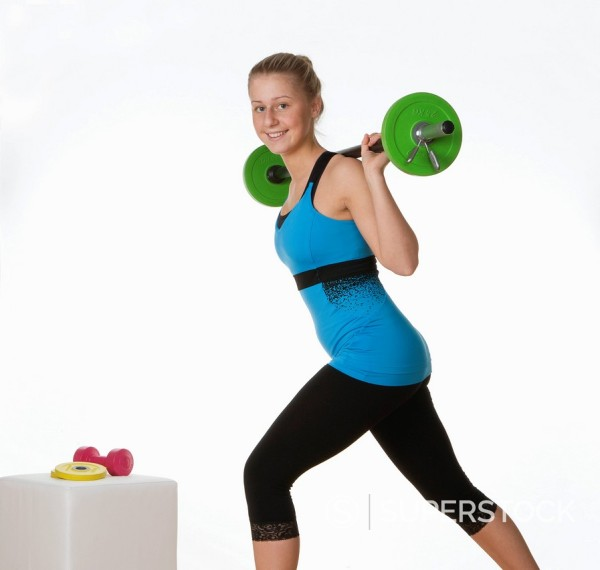 Stock Photo: 1815R-96833 Teenage girl exercising in gym, portrait