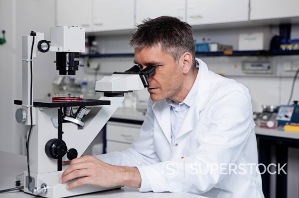 Stock Photo: 1815R-97006 Germany, Bavaria, Munich, Scientist with microscope in laboratory